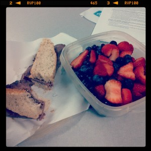 Roast beef sandwich on Italian Herb bread and fresh fruit