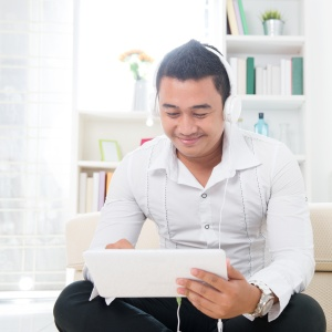 man with headphones and tablet