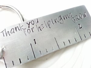 "Ruler that reads ""thank you for helping me grow"""