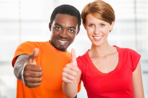 Man and woman giving a thumbs up