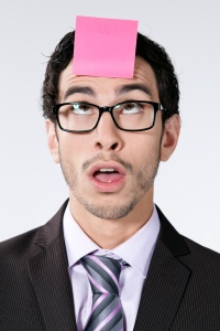 man with post-it note on his forehead